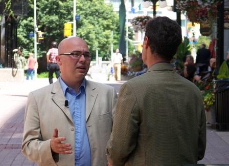 Steve Staples speaks with Global TV's Jacques Barbeau on Sparks Street in Ottawa.