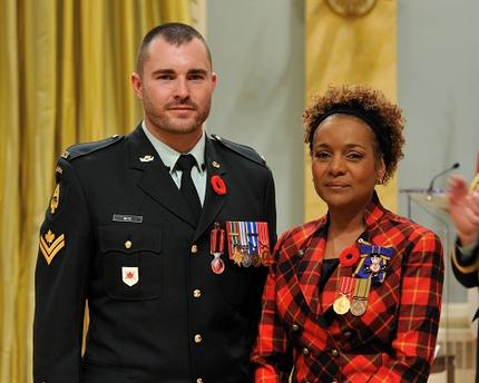 Governor General Michaelle Jean presents the new Sacrifice Medal to Master Corporal Jody Mitic in November 2009. MCpl Mitic was wounded in Afghanistan in 2007.