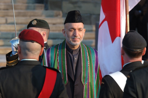Afghan President Hamid Karzai, who recently suggested he might quit politics and join the Taliban, visits Ottawa in 2006