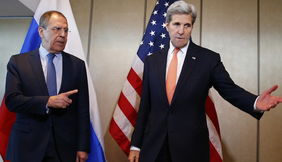 U.S. Foreign Secretary Kerry and Russian Foreign Minister Lavrov gesture before their bilateral talks in Munich